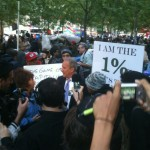 CEO Peter Schiff plays to the cameras at Occupy Wall St