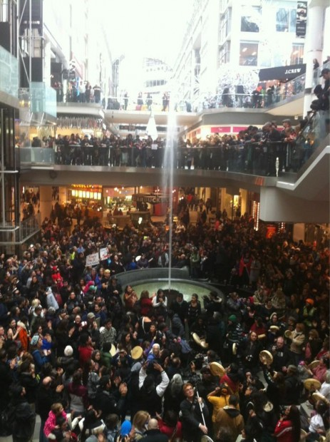 Marjorie Chan's stunning image of hundreds of Canadians setting an example in support of #idlenomore and Chief Theresa Spence at the Toronto Eaton Centre